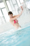 Swimming pool - happy woman under water stream Stock Images