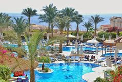 Swimming pool of Hilton Sharks Bay Hotel. The swimming pool in hotel of Egypt, landscaping, rest in the resort of the Red Sea in Sharm el-Sheikh, vacation Royalty Free Stock Photos