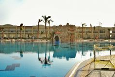 Swimming pool of Hilton Sharks Bay Hotel. The swimming pool in hotel of Egypt, landscaping, rest in the resort of the Red Sea in Sharm el-Sheikh, vacation Stock Photo