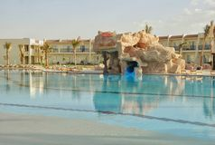 Swimming pool of Hilton Sharks Bay Hotel. The swimming pool in hotel of Egypt, landscaping, rest in the resort of the Red Sea in Sharm el-Sheikh, vacation Stock Image