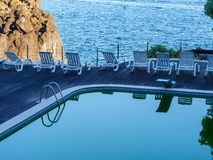 Swimming pool in a holiday resort with the sea in the background. Top down view stock images
