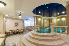 Swimming pool in hotel. Swimming pool in modern hotel Stock Photography