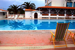 Swimming pool hotel. View from chaise Stock Images