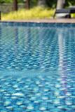 Swimming pool in a hotel with clear and clean blue water. Swimming pool in a hotel with clear and clean blue good looking and reflecting water in the morning royalty free stock images