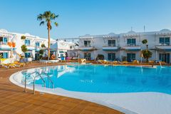 Swimming pool of the hotel complex Arena Hotel in Corralejo, Spain. Corralejo, Fuerteventura, Spain, April 03, 2017: Swimming pool of the hotel complex Arena Stock Image