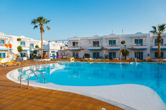 Swimming pool of the hotel complex Arena Hotel in Corralejo, Spain. Corralejo, Fuerteventura, Spain, April 03, 2017: Swimming pool of the hotel complex Arena Stock Images