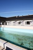 Swimming pool and houses Royalty Free Stock Images