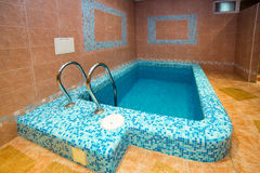 Swimming pool indoor. Comfortable relax spa interior Royalty Free Stock Photo