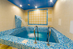 Swimming pool indoor. Comfortable relax spa interior Royalty Free Stock Image