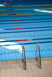 Swimming pool indoors. Indoors swimming pool with racing lanes stock photo