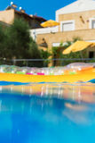 Swimming pool with inflatable raft. Royalty Free Stock Photography