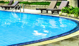 Swimming pool. Inside garden in hotel Royalty Free Stock Image