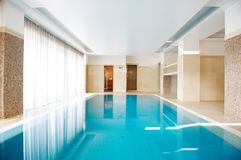 Swimming pool in Inside the house Stock Photography