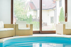 Swimming pool inside a modern residence Stock Images