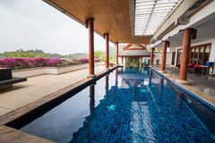 Swimming pool inside Thai style house Royalty Free Stock Photography