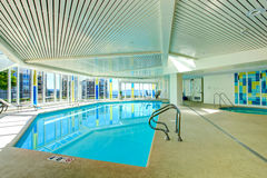 Swimming pool with jacuzi in residential building Royalty Free Stock Images