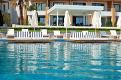 Swimming pool with jacuzzi by beach at the modern luxury hotel Royalty Free Stock Images