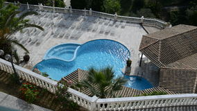 The swimming pool and jacuzzi at luxury hotel stock video