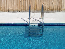 Swimming pool and ladder Royalty Free Stock Images