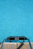 Swimming-pool ladder. An empty swimming-pool ladder stock photography