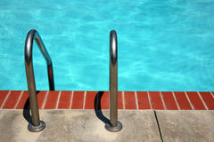 Swimming pool ladder. Ladder to either enter or exit the pool stock photos
