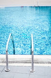 Swimming pool ladder on both sides. Swimming pool with ladders on both sides Royalty Free Stock Photo