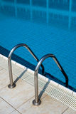 Swimming Pool Ladder. Close-up shot of a swimming pool stairs royalty free stock photography