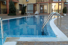 Swimming pool with ladder Royalty Free Stock Photo