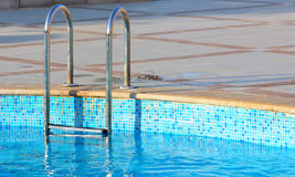 Swimming pool with ladder Stock Image