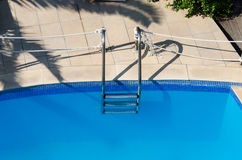 Swimming pool with ladder Royalty Free Stock Photography