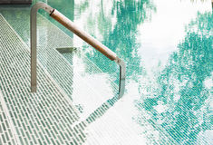 Swimming pool with ladder Royalty Free Stock Images
