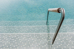 Swimming pool with ladder Stock Photos