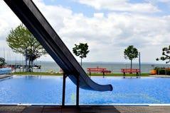 Swimming pool by lake. Slide over pool near lake Stock Image
