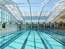 Swimming Pool. Swimming lanes at the bottom of an beginner level swimming pool Stock Image