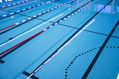Swimming pool. With lanes lined out tracks Royalty Free Stock Photography