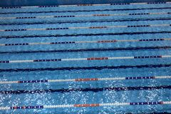 Swimming pool with lanes for swimming competitions Royalty Free Stock Image