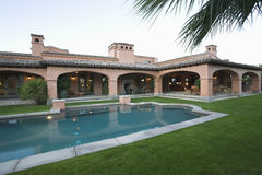 Swimming Pool And Lawn Against House Stock Images