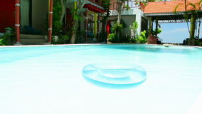 Swimming pool and lazy Inner tube, full HD. Stock Image
