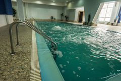 Swimming pool at the leisure center. Swimming pool with hand rails at the leisure center royalty free stock images