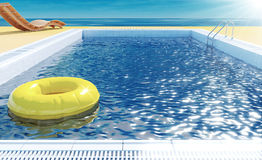 Swimming pool with life ring, beach lounger, sun deck on sea view for summer vacation. Blue swimming pool with yellow life ring floating on water surface, beach Stock Images