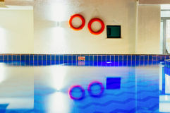 Swimming pool with life rings Royalty Free Stock Photo