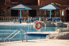 Swimming pool with life saver. In the holiday resoort in Hurghada, Egypt royalty free stock image