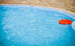 Swimming pool and lifebelt Royalty Free Stock Photography