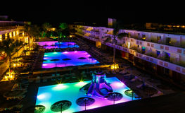 Swimming pool with lighting in spa modern European hotel at night royalty free stock images
