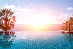 Swimming pool looking at blue sea view and blue sky background. Swimming pool looking at blue sea view and blue sky Stock Images