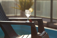 Swimming pool, lounge and wine glass with ice Stock Photos