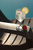 Swimming pool, lounge and wine glass with ice Stock Image