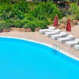 Swimming pool and lush vegetation Royalty Free Stock Photos