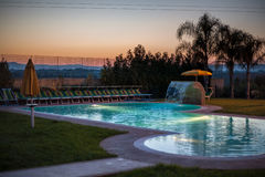 Swimming pool. A luxurious resort with a swimming pool at dusk Royalty Free Stock Photo