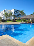 Swimming pool. Luxurious tropical hotel with a swimming pool Stock Photography